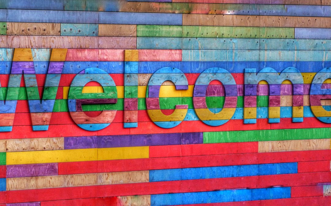 Colourful wall with a sign saying Welcome